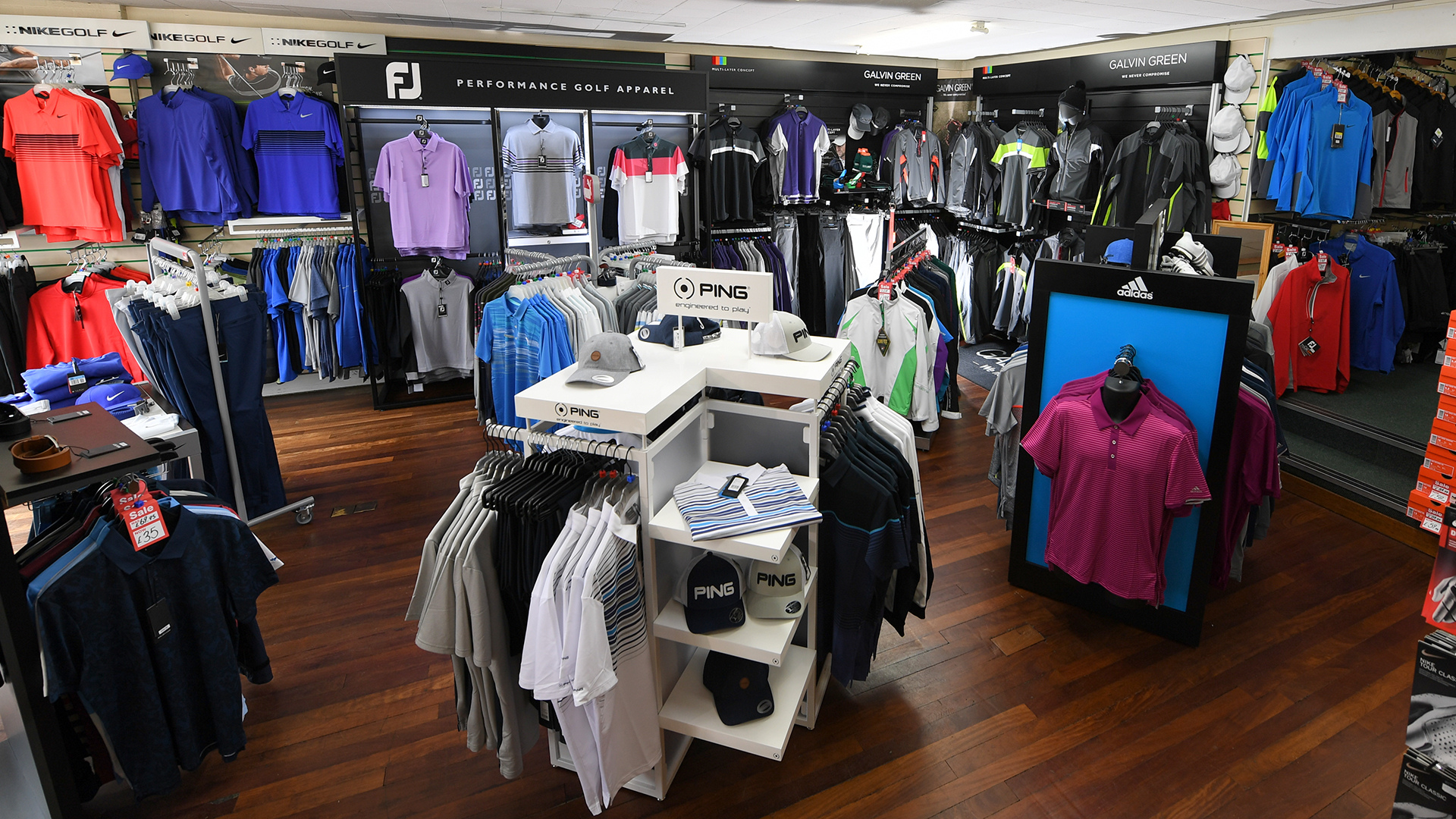 interior of Barrack Road shop showing golf clothing and accessories
